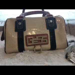 Guess black, cream, dark and light brown purse.